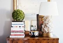 Vignettes / The arrangement of objects on a nightstand, or in an entry. Flowers, lamps, books, pictures and objects.