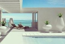 Modern Beach House / It's summer! Time to put your feet up, take in the ocean view and bask in the sun. Can't you just imagine yourself lounging (in a Gloster chair) on one of these decks?