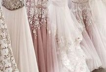 gowns / a long dress, typically having a close-fitting bodice and a flared or flowing skirt, worn on formal occasions.