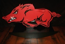 Arkansas Razorbacks / Favorite #ArkansasRazorback stuff. What do I mean by stuff?  Clothing, crafts, tailgating, posters, signs, jewelry, blankets, etc.  Please feel free to add your most interesting #Hog board here. But please remember that this board is limited to Arkansas Razorback pins.  Pinterest is not very good about letting me know who's following this board in order to be added to the list of contributors. If you want to be added please leave a comment to that effect. Thank you!