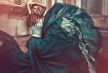 Dresses and Gowns / I dream of a world where women wear ball gowns every day. / by Manic Trout