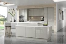 Gloss Kitchens / As a design trend, gloss doors are great for making smaller kitchen spaces feel bigger or simply creating an ultra modern look. Use a gloss finish throughout the whole kitchen or to add a splash of colour. See what you think of the Four Seasons range of gloss kitchens.  / by Moores Kitchens & Bathrooms