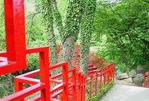 """Bridges / The Dow Gardens features several unique bridges. The oldest bridge at Dow Gardens, made with clinkers from coal furnaces, was built in 1904. Several Alden B. Dow-designed red bridges and the """"sun"""" bridge were added throughout the years."""
