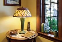An Eye for Art / Stained-glass light fixtures and rich tones are the epitome of Arts and Crafts style. Throw in some mood lighting and handmade furnishings, and your friends might start calling you Picasso.