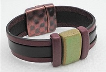 Euro Leather & Findings / We discovered beautiful silky Flat Italian Leather that comes in 5mm and 10mm in beautiful rich colors.  Our selection of Flat Leather Findings allow you to create fun and easy to assemble designs.  We are also launching Euro Round 5mm Leather and Findings.  This leather comes in many great colors and when doubled up the cords you can use many of the Regaliz (Licorice) Greek Leather Components. See more at antelopebeads.com