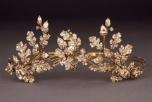 Tiara - My favourite / Tiara of oak-leaves and acorns, c 1855. Silver and gold, open-back, set with diamonds and convertible to a brooch or combs. Case labelled Hunt & Roskell, New Bond Street holds 2 tortoise-shell combs and gold frames for the tiara and brooch. The jewelled elements are interchangeable between the combs, the brooch-frame and tiara. Case is stamped with a Viscount's coronet and the initials 'MP' – ? Mary Selina Charlotte Portman, daughter of Viscount Milton married 2nd Viscount Portman June, 1855.