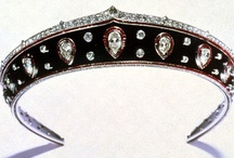 Tiara Variant - Kokoshniks / The Kokoshnik tiara takes its name from the traditional Russian folk headdress. The headdress was adopted by the Imperial family in the 19th century and used as the inspiration for jewelled tiaras worn at court. Family ties between the Russian and British royal families ensured that the Russian style was adopted in the West, where the kokoshnik tiara became fashionable in the late 19th and early 20th centuries.