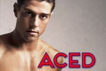 Aced (Blocked #2) / Aced is Book Two in the Sports Romance series Blocked, featuring volleyball player Maddie Brooks and Latino med student Alejandro Ramirez.