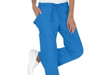 701 Scrub Pants / If you're looking for more fashionable scrubs that are also functional, you've got to try the 701 pant! They are amazingly comfortable and if you try them, you'll understand the many reasons our customers (and staff) love them! The easy-fit, low-rise pant is modern. It features an adjustable flat-tie drawstring waist, two front pockets, two back pockets, and a side cargo pocket. Fashion stitching, knee pleats, and a D-ring located on the left pocket.