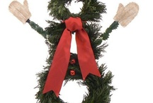 Christmas Wreaths /  A Christmas door wreath hanging on a front door to welcome holiday guests Christmas wreaths are a staple for the holiday decorating season.