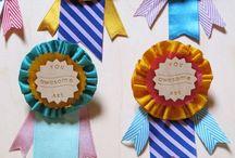 merit badges / by Vicki Lanzador