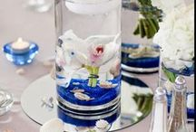 Cylinder Vases - Centerpieces / Wedding centerpieces that use cylinder vases at the core of their design.