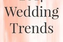2017 Wedding Trends / Rose gold, dusty blue, navy, greenery and grey are just some of the wedding color trends we are seeing this year. Long sleeve dresses, naked cakes, bohemian accents also top the list of gorgeous 2017 wedding trends.