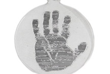 Custom Handprint Jewelry by My Forever Child / Handprint Pendants, Handprint Charms, Handprint Keychains, Handprint Necklaces that are engraved with your baby's, child's, or other loved one's actual handprint images for a truly customized and personalized keepsake. Solid Sterling Silver and 14K Gold