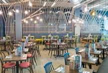 Zizzi Leeds the Light / Smack dab in the heart of Leeds' city centre leisure complex, one of our newer Zizzis stands ready to greet you. Our designers pulled inspiration from the city's strong roots in the textile and wool industry. There are colourful Knitted wool stools that have been inspired by the city where the material originated. We've even had a bespoke textile designed by Luke Trybula which forms the upholstery of the central seating feature. It's certainly a restaurant that turns heads.