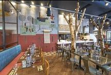 Zizzi Westfield White City / For our Westfield London restaurant we've drawn inspiration from the local surroundings & the large open spaces of Shepherds Bush Common. We've used lots of greenery & indoor plants to achieve the airy garden feel of a very relaxed environment. Zizzi Westfield is the perfect place for a much-needed break after a long day's shopping, a catch up with friends or a pre-cinema meal!