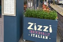 Zizzi Chiswick / We love each and every one of our Zizzi restaurants but Chiswick holds a special place in our hearts. We opened our very first Zizzi in the little suburb of Chiswick over 10 years ago. It's a favourite stop off for shoppers, families and parties who come for the warm welcome by our friendly team. Our Chiswick restaurant features an open pizza oven, signature silver birch trees & an illustrated mural inspired by the local Chiswick area.