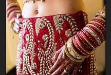 lehenga / A lehenga is a more current style of sari worn during special occasions such as weddings. It usually has a lot of bead work. Lehengas usually have hooks to hook them in place on the skirt and choli. / by Lynn Strano