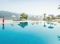 CLC Kusadasi Golf & Spa Resort / Kusadasi Golf & Spa is set hillside with stunning views across greenery to the Aegean. Stylish family apartments complemented with outdoor pools, one indoor; gym; spa; sports and an 18-hole scenic golf course next door.