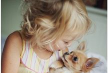 Puppy love. / Dogs are not our whole life, but they make our lives whole.  ~Roger Caras / by Carol Wicks