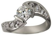 Modern Engagement Rings / We specialize in diamond engagement rings but have a variety of other fine jewelry and can customize any order. On this board we are showing modern engagement rings and ideas, we have princess cut rings, emerald cut rings, channel set rings, pave set rings, bezel cut rings, round cut diamond, pear shape diamond, halo style rings, marquise cut diamond ring and so much more.