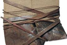 tied+bound / bundled, wrapped, encased, dangled, suspended etc...