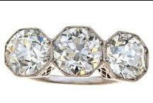 Weddings: Rings / Love white gold/silver bands and don't want prongs holding the stone, it needs to be smooth.