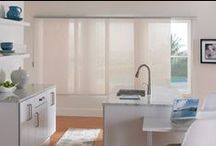 Panel Tracks / If a standard vertical blind doesn't quite fit your personal style, choose from a wide variety of vertical blind alternatives. Panel track blinds, for example, are one of the hottest products on the market today. The beautiful over sized fabric panels are individually attached to a track allowing them to glide easily from side to side for a wide array of aesthetic configurations.