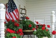Patriotic Front Porches / Show your patriotic spirit during the summer by flying Old Glory, hanging buntings, and decorating with red, white, and blue! #patrioticdecorations #patrioticfrontporches  #4thjulydecorations