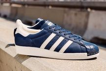 Sneakers: adidas Superstar / The adidas Superstar was launched 1969 as a low top basketball sneaker. Nicknamed the shell toe for their rubber shell topping the Superstar remains ever popular both on and off court.