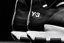 Sneakers: adidas Y-3 / The collaboration between renowned Japanese fashion designer Yohji Yamamoto and sports brand adidas revolutionized the sportswear industry, creating 'sportsluxe'. Y-3 represents design, craftsmanship, and the future in sportswear.   The fusion of innovative design, sport functionality, fashion elegance and spotless craftsmanship all accumulate to the success of Y-3 since its inception in 2003.