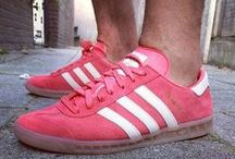 Sneakers: adidas Hamburg / Originally released in 1982 as a straightforward training shoe its unintended emergence as a street-ready silhouette coinciding with the casual movement of the early '80s. Retaining its classic T-toe design and rugged gum rubber outsole the Hamburg has been re-released in recent years.