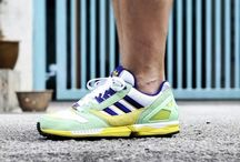 Sneakers: adidas ZX 8000 / The adidas ZX 8000 launched in 1989. Sometimes the colorway is everything, the ZX 8000 was introduced in a cornea-melting mix of aqua, purple and yellow that alone ensured the 8000 would stand out from it's predecessors. The Torsion system, Purolite Midsole and Monza F1 Outsole were the latest in sports technology at the time.