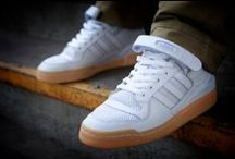 Sneakers: adidas Forum / Released in 1984, the adidas Forum and was the first adidas basketball shoe available in high- and low-top models. The Forum, which retailed for $100 when that meant something, featured a built-in strap and a high-high cut that was '80s perfect. It also featrues a leather or synthetic upper, hook-and-loop ankle strap, perforated accents, and a pivot point outsole for traction.