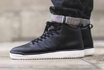 Sneakers: adidas Veritas / The adidas Veritas Mid released in 2014 takes inspiration from the classic adidas Forum, but the silhouette is streamlined, while a concealed lacing system adds to the update. Maintaining the modern vibe the Veritas comes in a range of fabric prints similar to the ZX Flux.