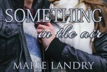 Something in the Air by Marie Landry / Everything in Rose Morgan's life is changing quickly. It's finally her time--time to figure out what she wants and what her future holds. Time to get swept off her feet and not fight it. But when her plans might take her away from all the amazing new things in her life, including Declan Connelly, Rose has to make a choice. Is she willing to chase her dreams, even if it means letting go of love?