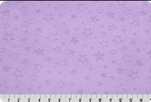 Embossed Star Cuddle / This soft and plush Cuddle minky fabric features a variety of small embossed stars in different sizes; some are solid; some are outlined. A great blender and perfect for baby accessories and blankets, quilts and more. / by Shannon Fabrics