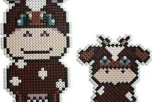 Perler Beads / by Kim Roland Jarratt