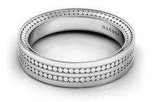 His Bands / The designs of these masculine and unique wedding bands are inspired by the bride's engagement ring and symbolize the endless love of his wedding promise.