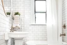 Farmhouse Bathroom / Farmhouse style bathroom inspiration full of white subway tile, shiplap, beadboard, antique tubs, farmhouse sinks, lots of white and breezy windows. Bright white, wood tones and a touch of black.