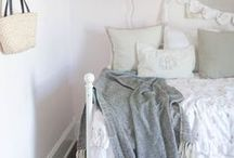 Farmhouse Girls Room / Farmhouse design inspiration for little girls' rooms; vintage florals, shiplap, pretty throw pillows, muted colors, wicker baskets, bright white and layers of cozy textures.