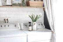 Farmhouse Laundry Room / Farmhouse laundry room design inspiration; bright white, fresh flowers, subway tile, shiplap, farmhouse sinks, open shelving and wicker baskets.