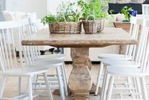 Farmhouse Dining Room / Ironstone plates, simple chandeliers, farmhouse tables, grain sack and fresh greenery, natural fiber rugs, chippy furniture and all things that make up a classic farmhouse dining room.