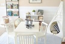 Farmhouse Playroom / Colorful, rustic, playful and fun...our inspiration for playrooms filled with books, dress up and all things that inspire imagination. Adorned with shiplap, edison bulbs, repurposed antiques, striped rugs, swing arm lamps, wall maps and craft supplies, all with a touch of farmhouse charm.