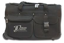 Black Dream Duffel® / Our Dream Duffel® has everything you need! It features a one-touch telescoping garment rack, fully-lined accessory pockets, an insulated snack pocket, an integrated stool pocket, and removable personalized patches! Plus, it's all on wheels with a convenient pull-out handle for easy transport! | Available in Small, Medium, and Large | www.dreamduffel.com