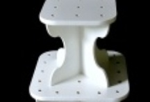 Push Pop Stands / We manufacturer a variety of Push Pop Stands available in black or white, and in 7 different sizes.