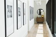 Hallowed Halls / Long hallways may present a design challenge, but the right combination of statement lighting, artwork, and beautiful finishes can create a dramatic effect in a unique space.