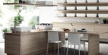Qi_Kitchen / The fundamental concept, the idea that underpins this kitchen, is to conceal it using two elements, because the kitchen, in contrast, is always full of so many objects: hiding it by means of wooden shelves and white storage units