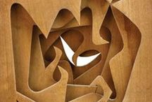 Material: Wood / Modernist and contemporary designs made using wood. Natural but not organic. aram.co.uk
