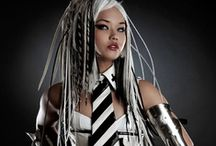 GENRE: Cyber/Goth / Cybergoth is a subculture that derives from elements of cyberpunk, goth, raver, and rivethead fashion. Unlike traditional goths, Cybergoths follow electronic dance music more often than rock. / by David Nelke